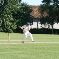 cris-taylor-drives-during-cricket-match